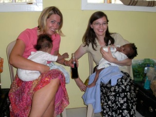 Carmen and Mary holding babies from Manna Abdii and sneaking Cokes so all the kids don't see.