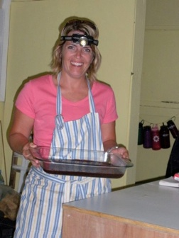 Carmen getting a taste of what it's like to cook in the dark - come on, the headlamp look is cool!