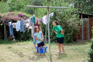 The Kennedy kids helped make the chore of hanging laundry seem fun!