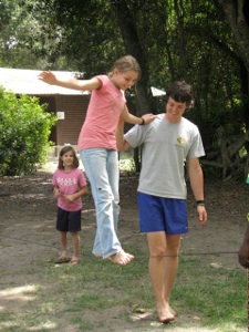Hannah and Mia learning how to walk a tightrope with Scott, a short-termer here for the summer.
