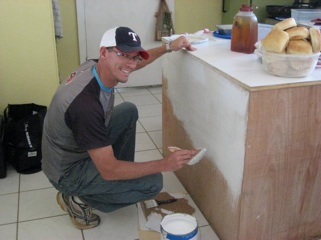 Bryan painting our kitchen cabinets.