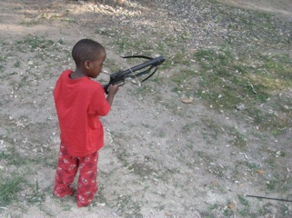 Moses in his p.j.'s with his toy crossbow - a common site.