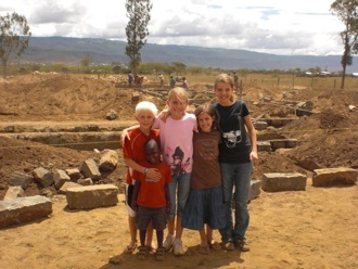 The kids in front of the construction site of Naomi's Village (the orphanage the Mendonsas are helping to construct).