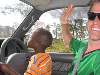 Moses drove us through the safari at Lake Nukuru on Bob's lap.
