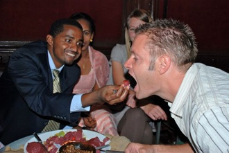 After the ceremony, we went to a restaurant to enjoy an Ethiopian feast... complete with raw ox. Abera enjoyed feeding Shane bite after bite... after bite!!