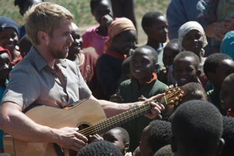 Josh played his guitar for the kids at the IDP camp – they weren't sure what to make of him!
