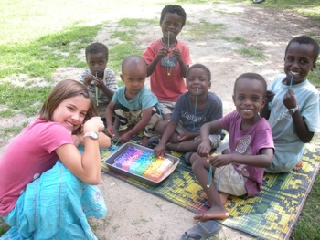 Mia helping the local kids make necklaces with the supplies the Henrys sent - thanks guys! It's been lots of fun.