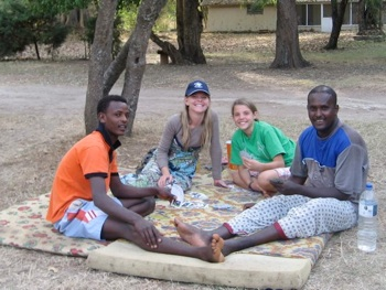 Kara and Hannah playing cards with the workers who live next door.